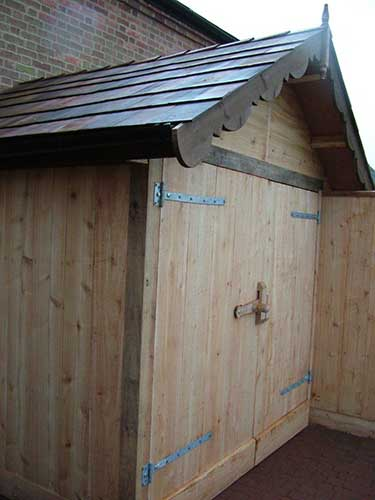 Cedar outhouse with shingles oak lock
