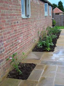 York stone patio planting pockets in Calne