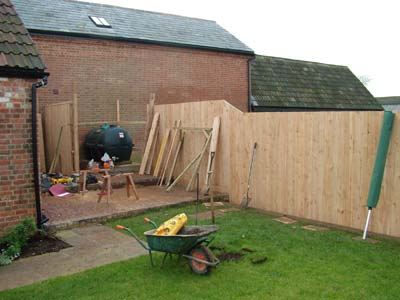 Wide plank cedar fence landscaping in Calne, Wiltshire